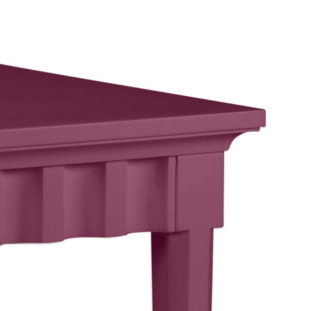 Scallop pattern design on console and finish is Benjamin Moore Grape Juice. Made of acacia wood.