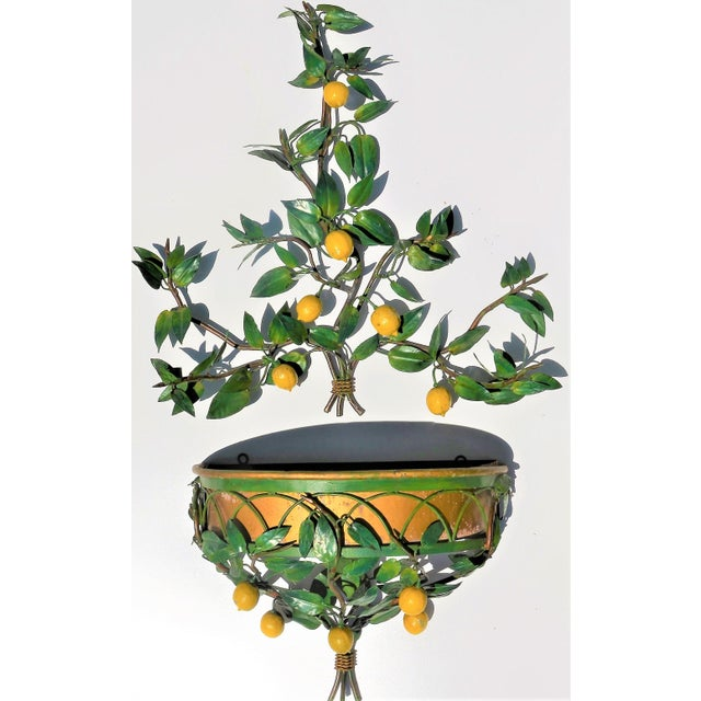This is an incredible mid century (we believe 1960's -1970's) hand painted Italian tole lemon tree wall candelabra /...