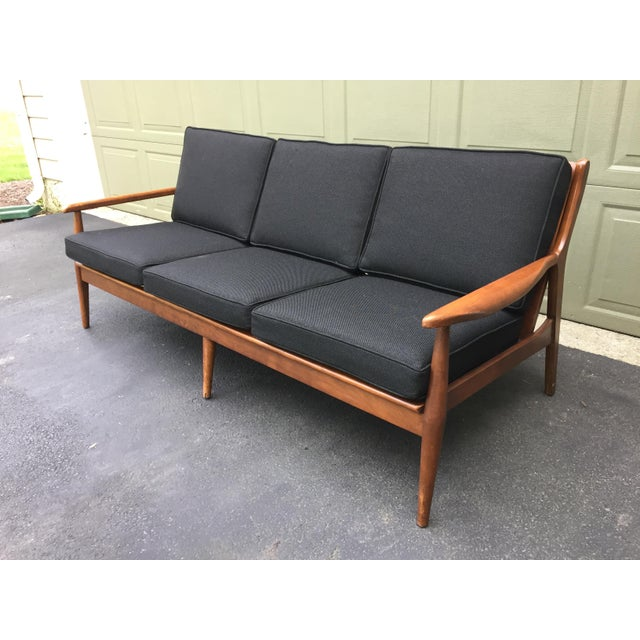 Get the best of both worlds with this Danish modern style walnut open arm sofa. All new professional reupholstery,...