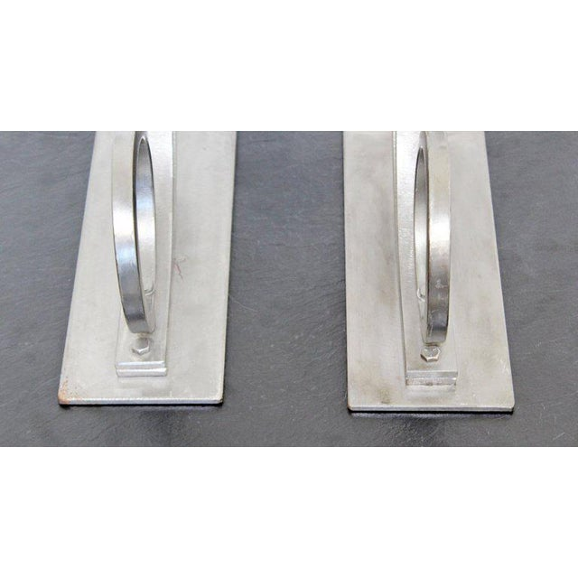 For your consideration is a stunning pair of sculptural candleholders, made of aluminum, with two heads each, signed on...