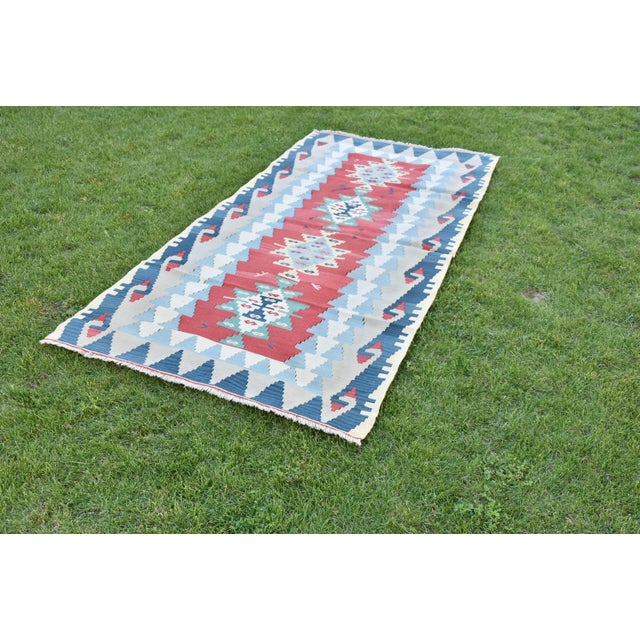 Size: 3.6 x 7.4 ft (110 x 225 cm) 43.3 x 88.6 inches. Includes red and blue rugs. All rugs are handwoven by the...