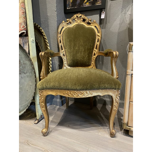 This baroque Louis XIV armchair features a beautiful olive green mohair fabric and wood made with gold leaf. This...
