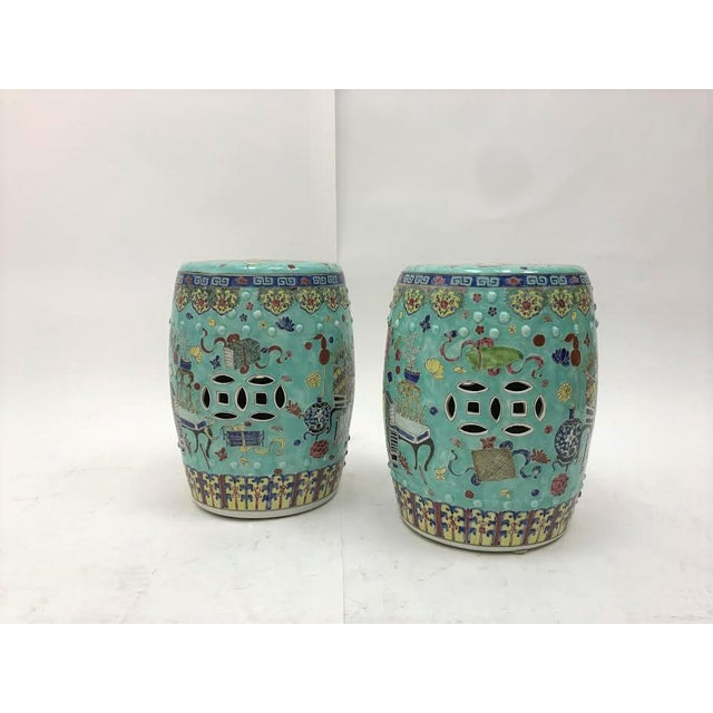 A pair of aqua and multicolored Chinese ceramic medallion garden seats or side tables. Wonderful accent pieces!