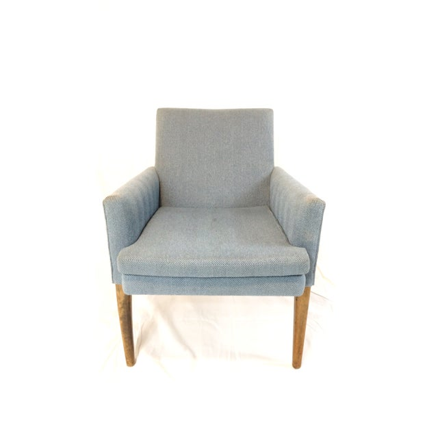 A small scale arm chair with great form, Danish modern in style though it has no markings or identification. Fabric is...