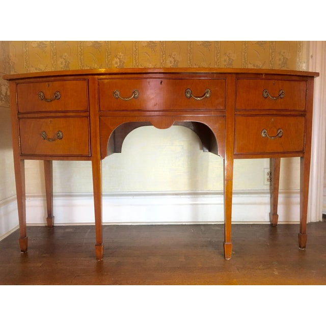Mahogany-serpentine English sideboard of classic Sheraton style. Stunning period replica from the elite house of Arthur...