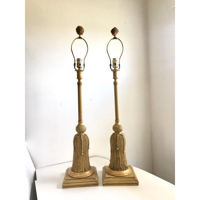 A monumental pair of vintage Hollywood Regency Rope & Tassel table lamps. These lamps are spectacular and will make a...