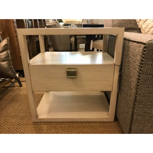 This little side table has a lot going for itself, including mahogany solid and veneers with a beautiful white wash, a...