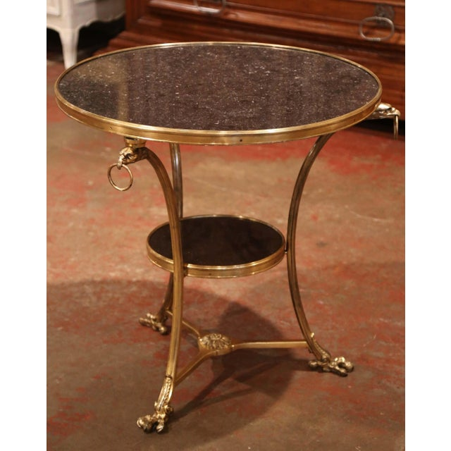 This gilt bronze guéridon table was created in France circa 1920, round in shape and supported by three slender cabriole...