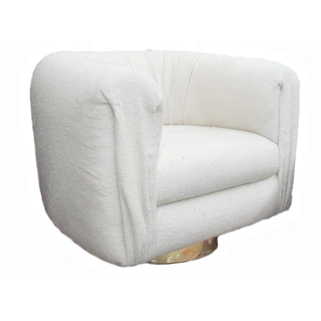This is a designer barrel club chair in excellent vintage condition. The fabric has normal wear but the cushion is still...