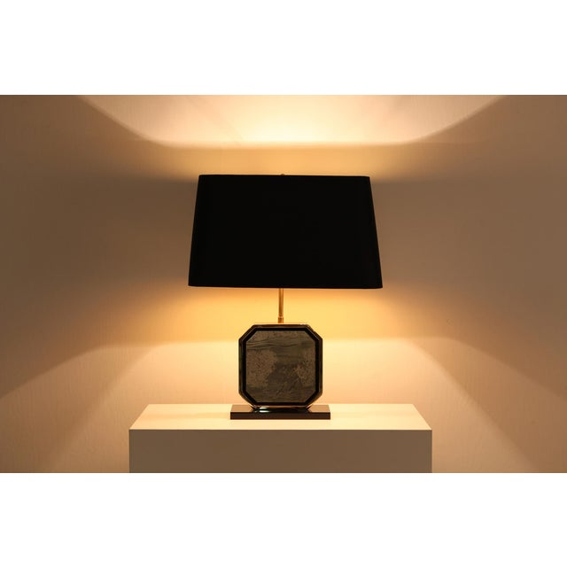 Glam table lamp in Hollywood Regency style. Luxury piece with a 24-Karat gold plated brass frame and a brass etched...