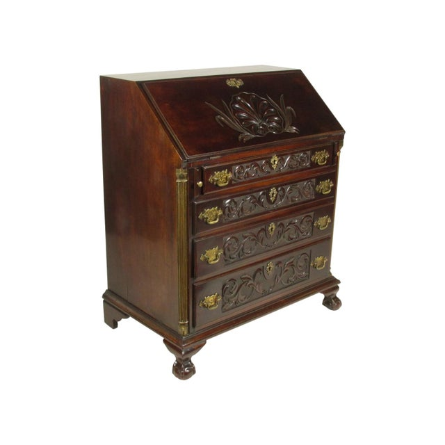 Late 19th-C. Georgian-Style mahogany slant-lid desk with hand carved details, a writing compartment with multiple cubbies...