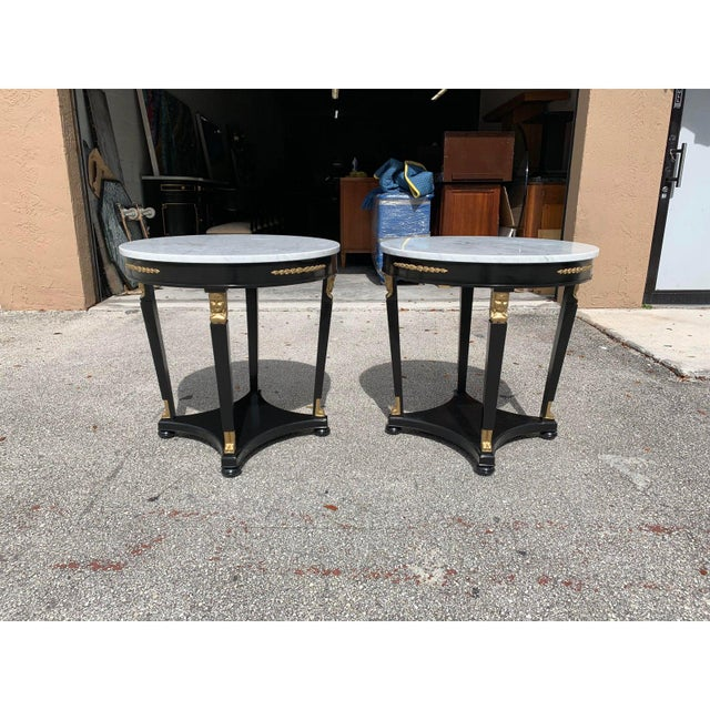 Monumental Pair of French Empire Marble Top Accent Table or Gueridon Table 1910s, made of mahogany with a beautiful...