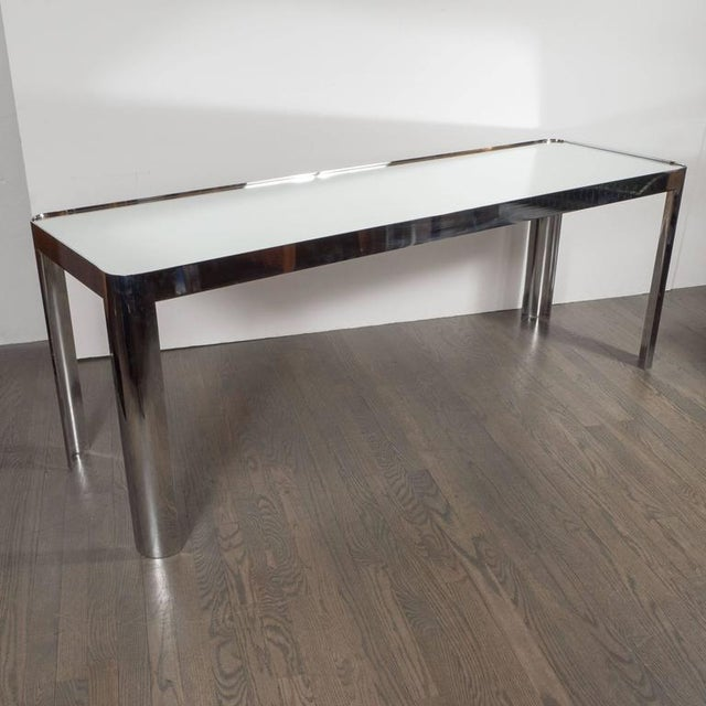 This Mid-Century Modernist console table features a mirrored top and lustrous polished chrome legs. The two materials...