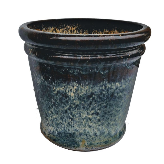 A large hand thrown kiln fired Italian style artisanal terracotta planter. It's drip glazed in glossy intentionally uneven...