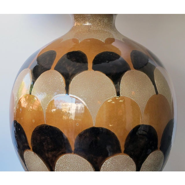 each large lamp glazed in an overlapping glaze in muted tones of ivory, russet and black
