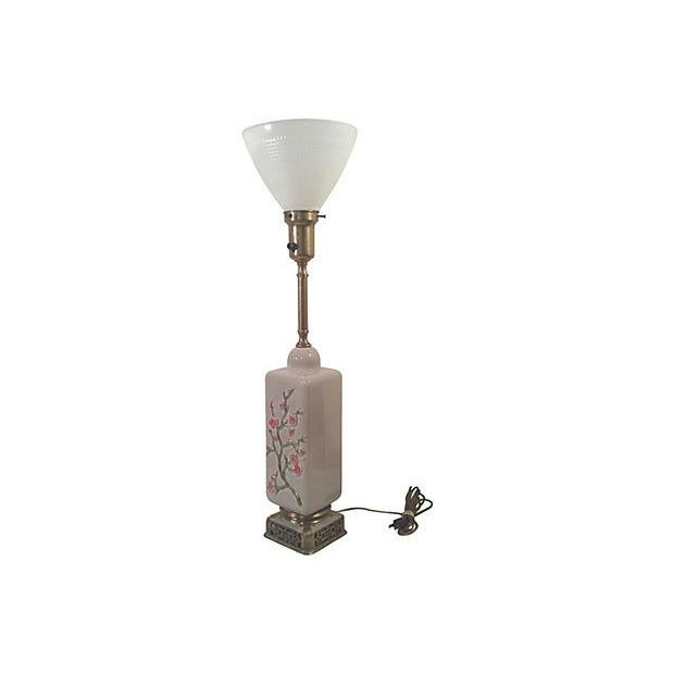 Rembrandt Asian ceramic table lamp in a gray color decorated with a raised cherry blossom design. This well made vintage...