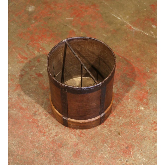 This antique grain measuring recipient was crafted in France, circa 1870. The bucket features metal straps, forged nails...