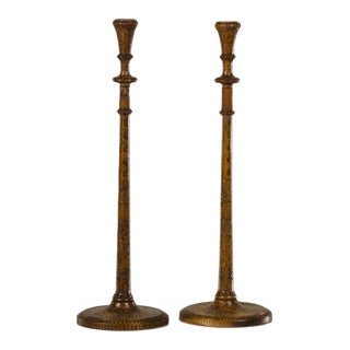A pair of tall and slender candlesticks carved with poker work decoration from England c.1880.