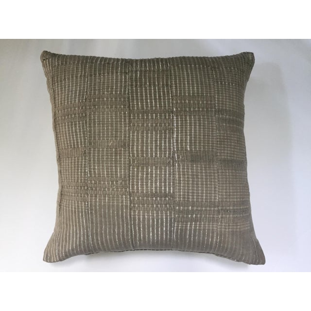 A pillow newly made with a vintage African Aso Oke textile. Silver metallic threads throughout and heavily stitched...