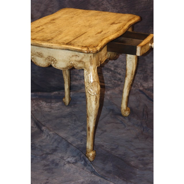 Writing or side table by William Switzer hand carved in French Country style painted with a rustic antique finish.