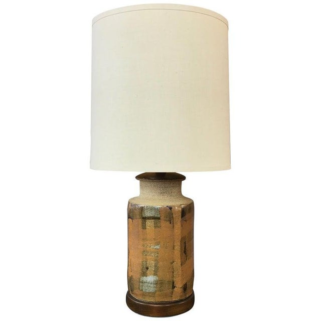 An especially handsome and well-crafted Mid-Century Modern stoneware and walnut table lamp by renowned California ceramic...