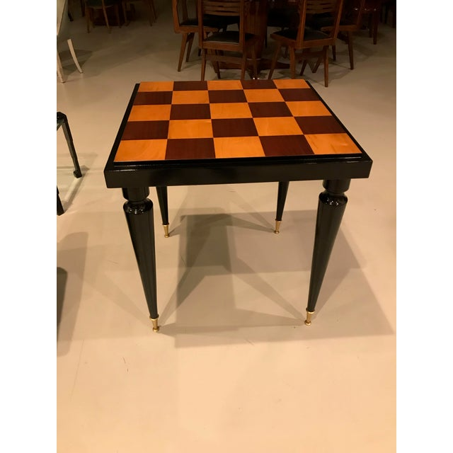 French Art Deco ebony game table or centre table, circa 1940s. Refinished high gloss finish.