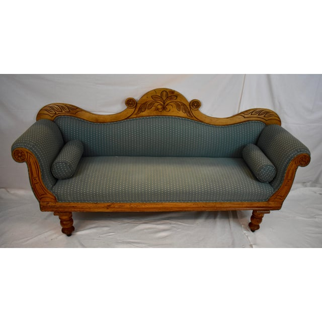 More an upholstered settle than a sofa, this beautiful and rare settee is an Irish journeyman's interpretation of the...