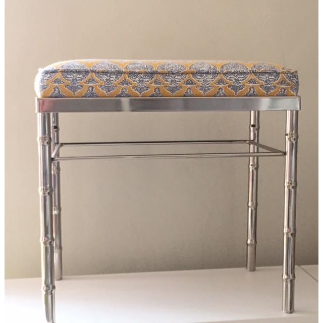 Newly upholstered, perfect for a vanity or use as an ottoman and kick up your heels in style. Vintage chrome bench newly...