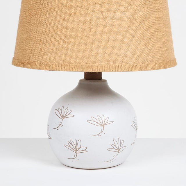 1960s Gordon Martz/Marshall Studios lamp with walnut detail and incised design into matte white glaze, new wiring.