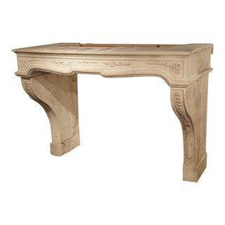 18th Century French Fireplace Mantel in Carved Limestone For Sale