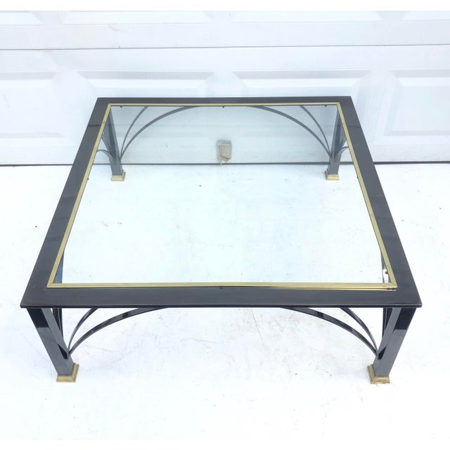This stylish modern end table features an elegant mix of dark chrome and brass details, a sturdy table that makes an...