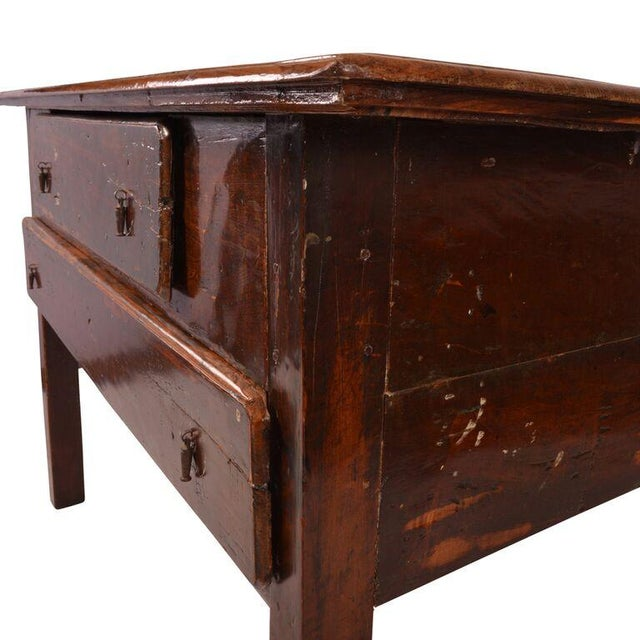 Primitive with a highly refined finish, this antique Brazilian table with two drawers has been hand-rubbed to a high gloss...