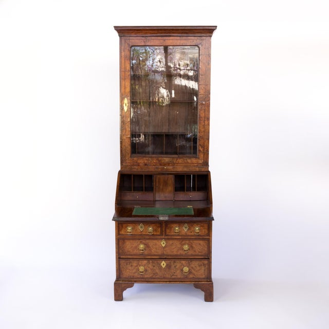 Early 18th century, Georgian figured walnut and feather banded bureau bookcase with single door with original glazing,...