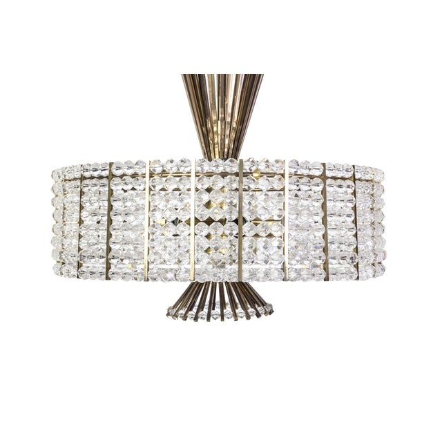 This sensational Mid-Century Modernist chandelier was designed by Emil Stejnar For Rupert Nikoll. It features a circular...