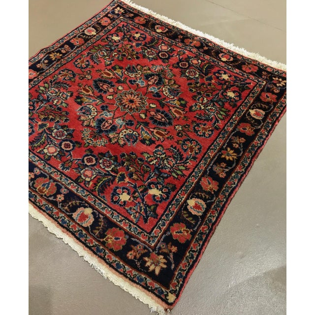 An old, hand knotted Persian wool rug made in the rug weaving district of Hamadan, circa 1920. An uncommon squarish...