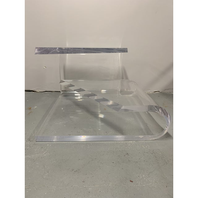 Gorgeous thick and heavy lucite accent / side table by designer Charles Hollis Jones. Signed by the artist on the back, it...