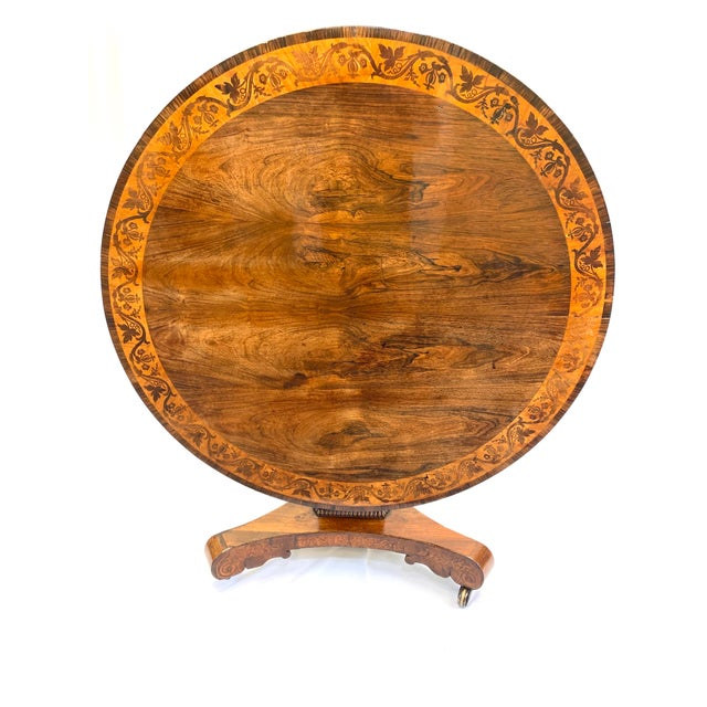 Gorgeous English Regency period tilt top breakfast table with Rosewood marquetry inlay banding. We recently French...