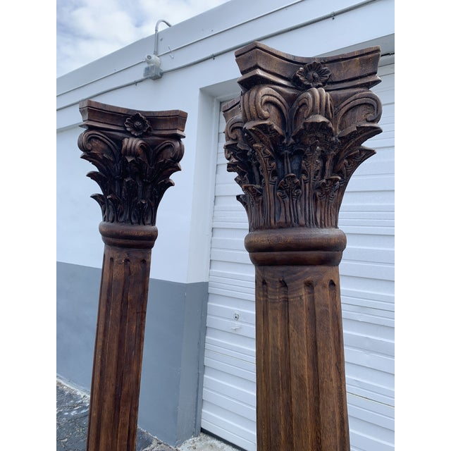 Pair of antique columns. These dramatic architectural elements stand six and half feet tall! Vivid, stunning natural wood...