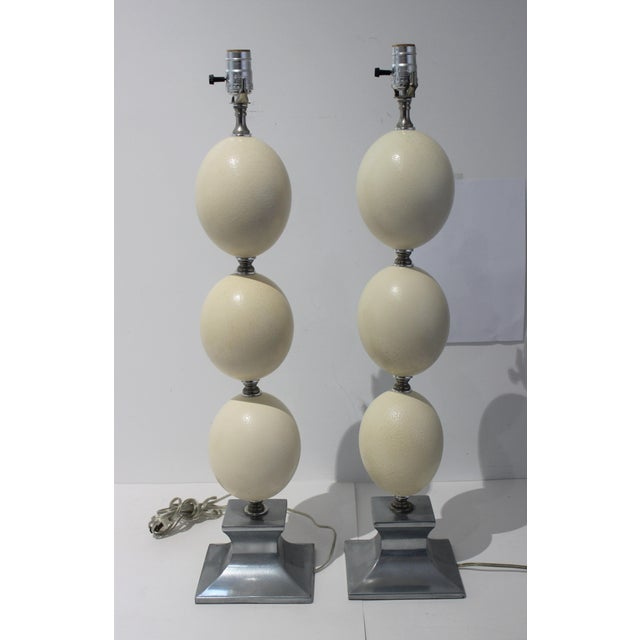 This stylish set of table lamps are fabricated with natural ostrich eggshells with polished chrome and aluminum mounts.