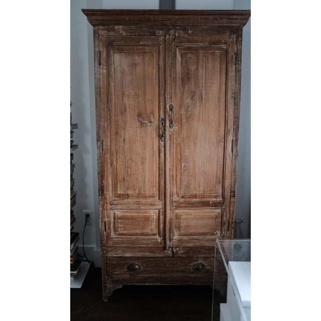 This armoire is in near perfect condition. If it has blemishes, I can't find them. It functions as amazing storage and...
