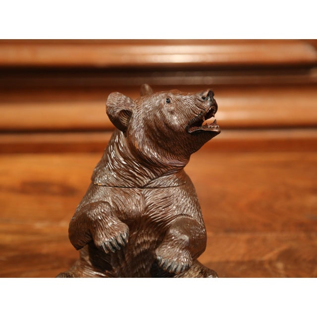 This beautifully executed, antique bear sculpture was crafted in Switzerland circa 1870. The mammal is in a seated...