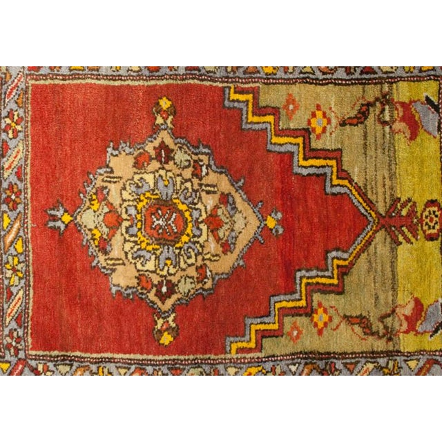 An early 20th century Turkish multicolored Oushak prayer rug with multiple geometric designs surrounded by multiple...