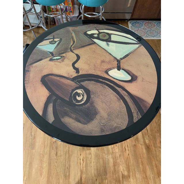Vintage Mid Century Modern custom painted cigar and margarita glass round table top cafe bar table. It appears to be a...