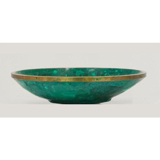 Large Malachite modern and sculptural bowl. A tessellated bowl has a bronze rim. The bowl has classic forest and emerald...