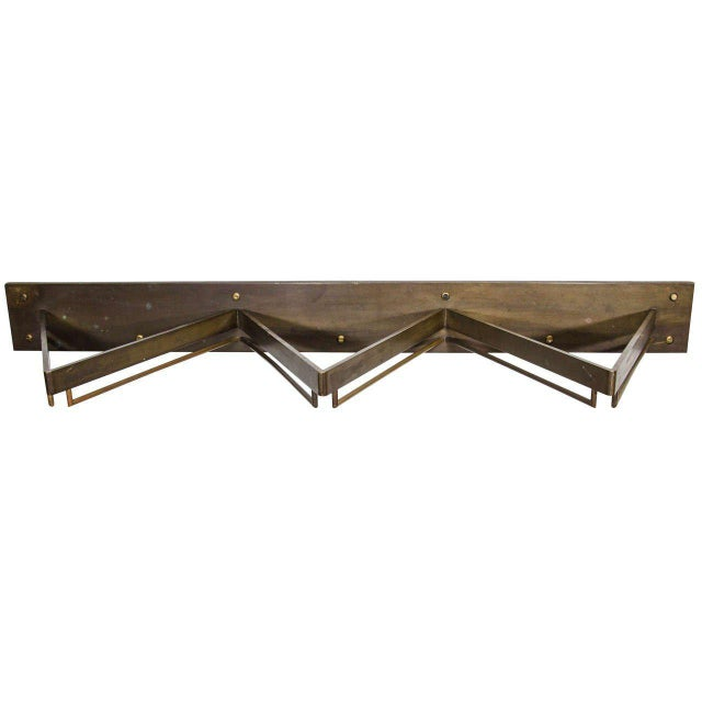 Brass wall-mounted display shelf from hermes. It can be used as a rack or console with an addition of a piece of glass on...