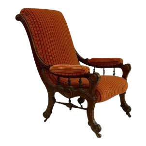 American Victorian Eastlake style burl walnut and gilt trimmed sleigh back arm chair with striped upholstery