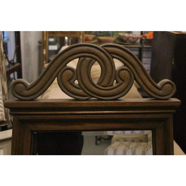 Pair of angular art nouveau mirrors made of brown painted wood and curling shapes.