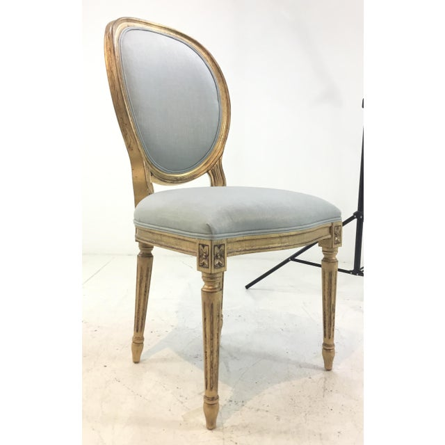 Original Retail $6300, super chic Currey and Co. French Style Palais Blue and Gold Side Chairs Pair, wood frame finished...