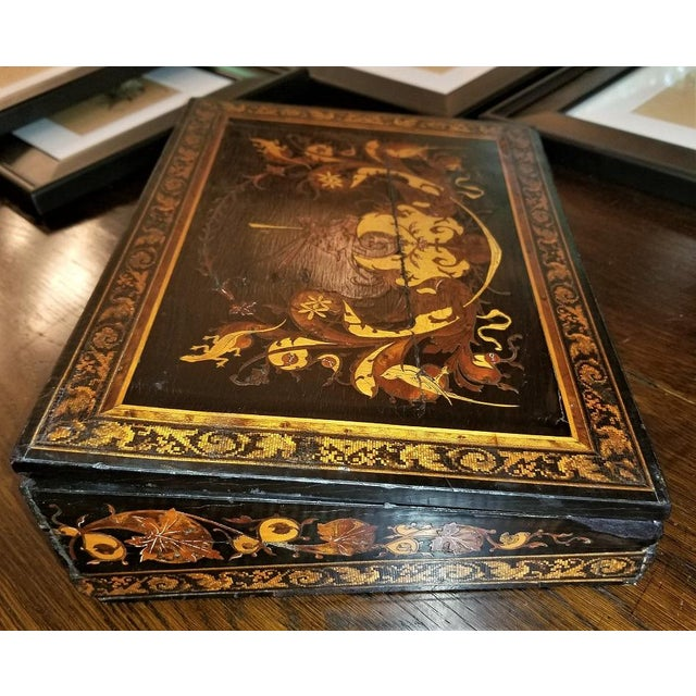 Presenting an absolutely gorgeous and extremely unique and rare 19th Century British Tunbridge ware lap desk. This lap...