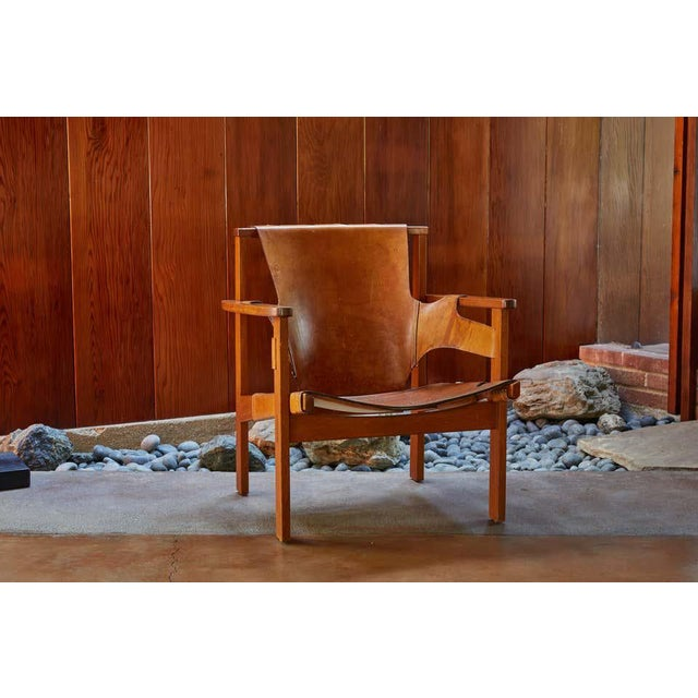 Carl Axel Acking 'Trienna' chair in patinated brown leather, circa 1957. Executed in perfectly patinated cognac brown...